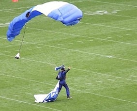 The Penn State parachutist who did land on the pitch – the other landed on the railway track alongside the stadium!