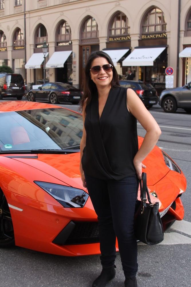 Sabrina Vonsowski from Club Travel checks outa Lamborghini in Munich.