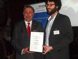 Klaus Lohmann congratulates first prize winner Aran Brazil, Irish Sun