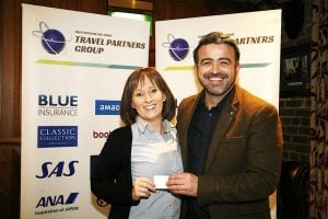 Lorraine Power, Harvey Travel, receives a voucher from Lee Osbourne, BookaBed