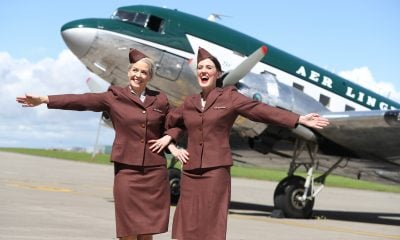 Repro Free: Thursday 21st July, Dublin Airport: Aer Lingus welcomed a piece of Irish aviation history into its hangar at Dublin airport today as it received a Douglas DC-3 aircraft hailing from the 1940s and 50s and freshly painted in the Aer Lingus livery of that era. The DC-3 was the fifth aircraft type to be operated by Aer Lingus in 1940 and at that time was part of a fleet of just 5, while today's fleet now stands at 63 aircraft operating more than 100 routes to UK, Europe and North America. The DC-3 aircraft will feature in Bray Air Display and Foynes Air Show this weekend. Pictured are Aer Lingus cabin crew Sarah Jane Bennett and Christina Foley wearing the airline's 1940s uniform together. Picture Jason Clarke