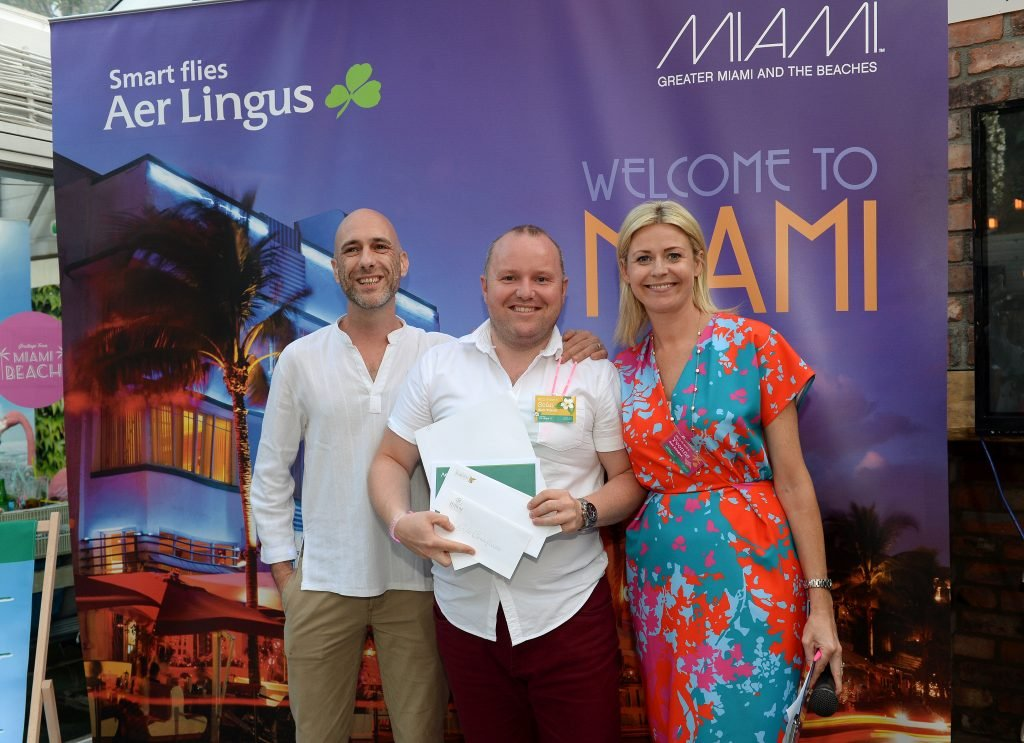 Seb Sarrasin, left, from Greater Miami CVB, and Yvonne Muldoon, Director of Sales - Aer Lingus, present prize to Sean McCarthy, from Club Travel.