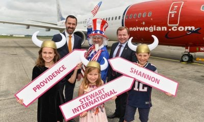 REPRO FREE 02/07/2017  Exciting new transatlantic services commence at Shannon Airport as Norwegian Air International begin operations.  Pictured are, from left,  siblings Erica (11), Rhea (8), and Cian Murphy (10) from Castletroy, Limerick, with Andrew Murphy, MD, Shannon Airport, left, Tore Jenssen, CEO, Norwegian Air International, right, and 'Uncle Sam' Aidan Fox from Shannon. Photo: Diarmuid Greene / True Media  Shannon Airport today heralded a new departure in transatlantic aviation as the first ever services to US the east coast airports of Stewart International in Orange County and Providence, Rhode Island were commenced by Norwegian Air International.  Giving Shannon its largest number of transatlantic destinations for 17 years, the new services are a huge boost for tourism across the airport's wide catchment, from the North West down to Cork, delivering additional services from the largest yielding market in terms of visitor spend in Ireland.  Two weekly flights to Stewart International Airport, Orange County – just 90 minutes from New York – and Providence Green Airport, Rhode Island will be added to the already strong Shannon US schedule.  The new services create an unprecedented line-up to the USA from Shannon Airport, with five airlines, seven destinations and eight services.