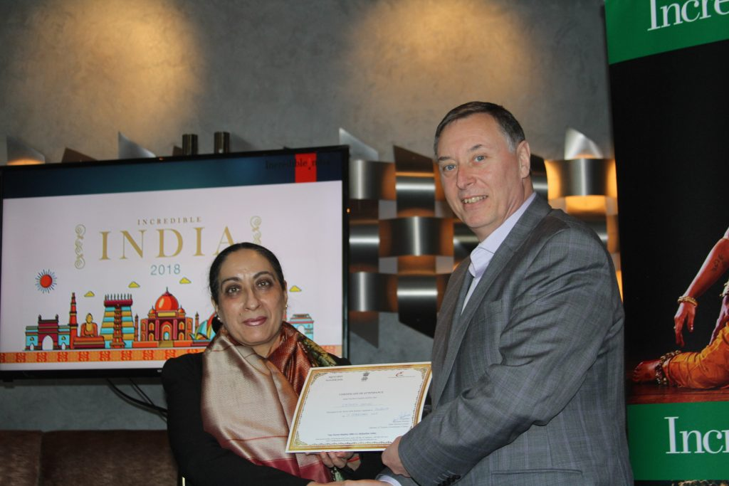 He the Indian Ambassador presents a certificate to Stephen Sands from Riveria Travel.